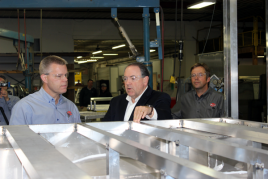 Huckabee looking at truck frame.png